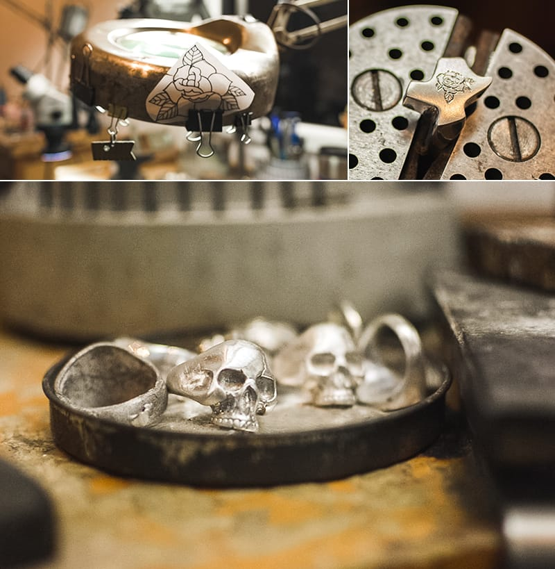 A larger reference drawing of a rose is clipped to Branden's work light for the etching in progress on a tiny Texas. Skull rings fill a container nearby.